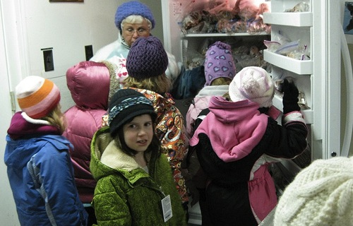 You can celebrate the day after Christmas with a special behind-the-scenes tour to learn how the Audubon Center and Sanctuary cares for Liberty, its non-releasable bald eagle. Volunteer Linda O'Brien is seen here showing a group of Girl Scouts Liberty's supply of frozen fish. (Photo by Jennifer Schlick)