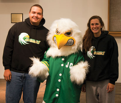 JCC students Zach Hallberg and Sydney Milliman pose for a picture with newly christened JJ the Jayhawk.