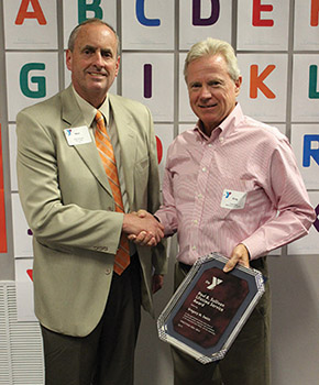 Courtesy photo. Greg Smith, YMCA Trustee, right, receives the Paul B. Sullivan Lifetime Service Award presented by Mark Eckendorf, YMCA CEO, left, at the recent Jamestown Area YMCA annual meeting.
