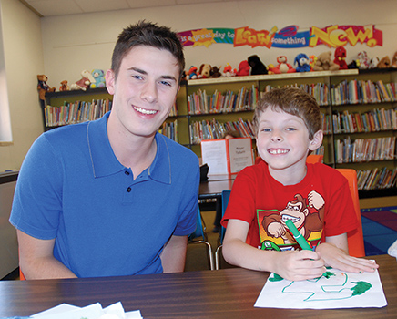 Courtesy photo. JHS Senior Alex Harvey helps Fletcher Elementary School student Andrew Marucci during Chautauqua Striders after school tutoring.