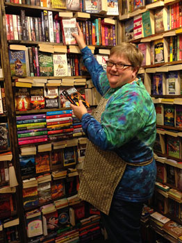 Owner, Carrie Wolfgang, shelving some of her favorite titles.