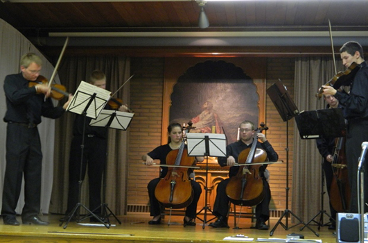 The Chautauqua Regional Youth Symphony will hold auditions for all three of its orchestras on January 9 and 10, 2016, in the Reg Lenna Center for The Arts. Some of the Youth Symphony's string players are shown here performing at a Scandinavian Foundation holiday dinner at Holy Trinity Church in Jamestown. Director Bryan Eckenrode is playing with them on the left.