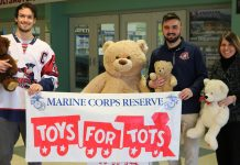 Representatives from the Jamestown Rebels and The Resource Center pose with some stuffed bears. Pictured from left are Team Captain Eric Olson; Tommy Gerace, the Rebels' director of community relations; and Terri Johnson, TRC's director of employment and community-based services and one of the lead organizers of the local Toys for Tots drive.