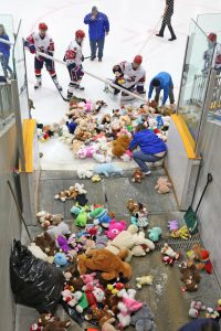 Jamestown Rebels players and Northwest Arena officials collect some of the toys at last year's Teddy Bear Toss.