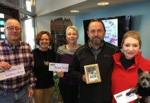 """Mitch Stone, Southern Tier Kidney Association; Tory Irgang, Community Foundation executive director; Kellie Roberts, Chautauqua County Humane Society; Jamie Billquist; and Bobbie Thompson with Harris, Pet Therapy Program; celebrate the first awards from the Rosemary """"Rosie"""" Billquist Memorial Fund."""