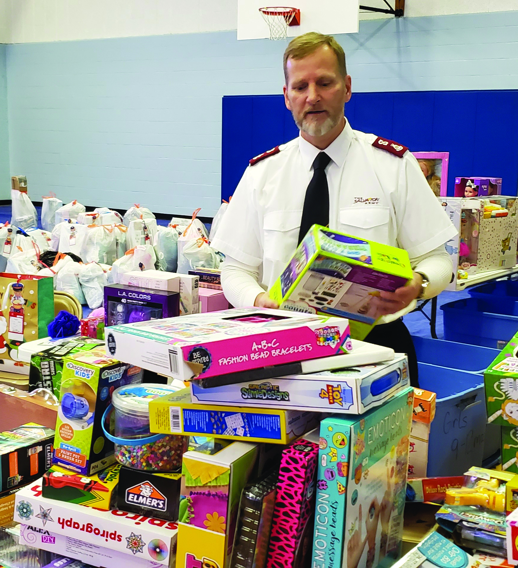 Major John Merchant at the Salvation Army checks toys donated for Christmas toy delivery.