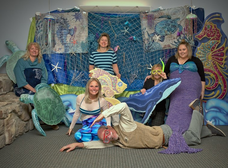 CHPC staff enjoy a fun moment in preparation for the Under The Sea gala.