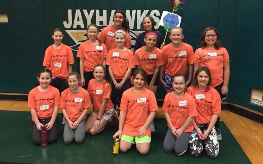 2019 Get in the Game group leaders standing in back from left, Sophia Dumaine and Susan Kalfas, gather with their group of girls between sports sessions.