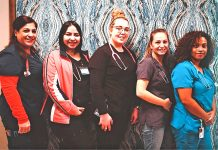 Several of the Chautauqua Center's medical assistants and nurses at the beginning of their shift on Friday