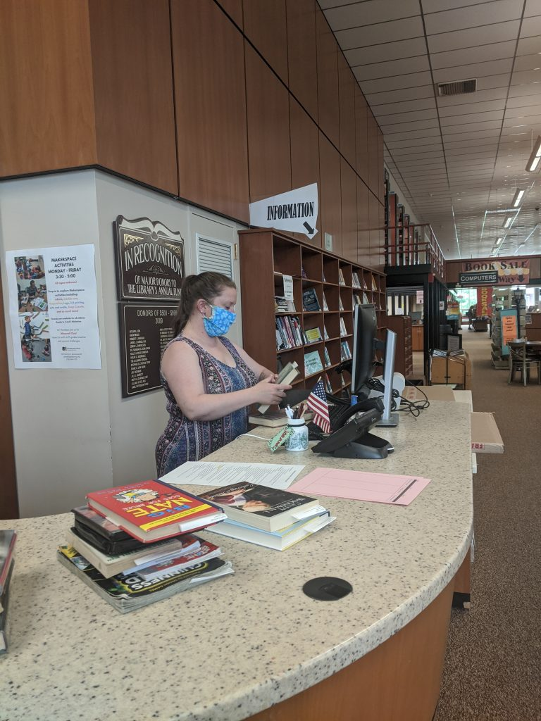 Library staff prepare the books for curbside pickup which is available throughout the day and Saturday.  Sign up for your time by calling the library at 484-7135.