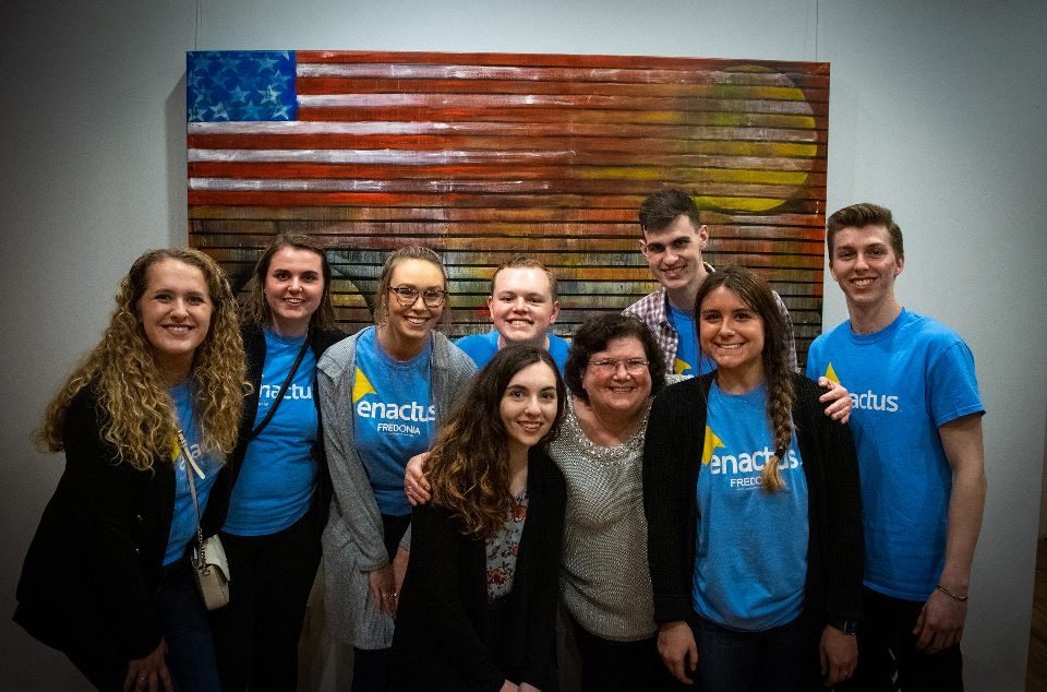 Enactus students with Dr. Susan McNamara at The Art Market on Main Street in Fredonia.