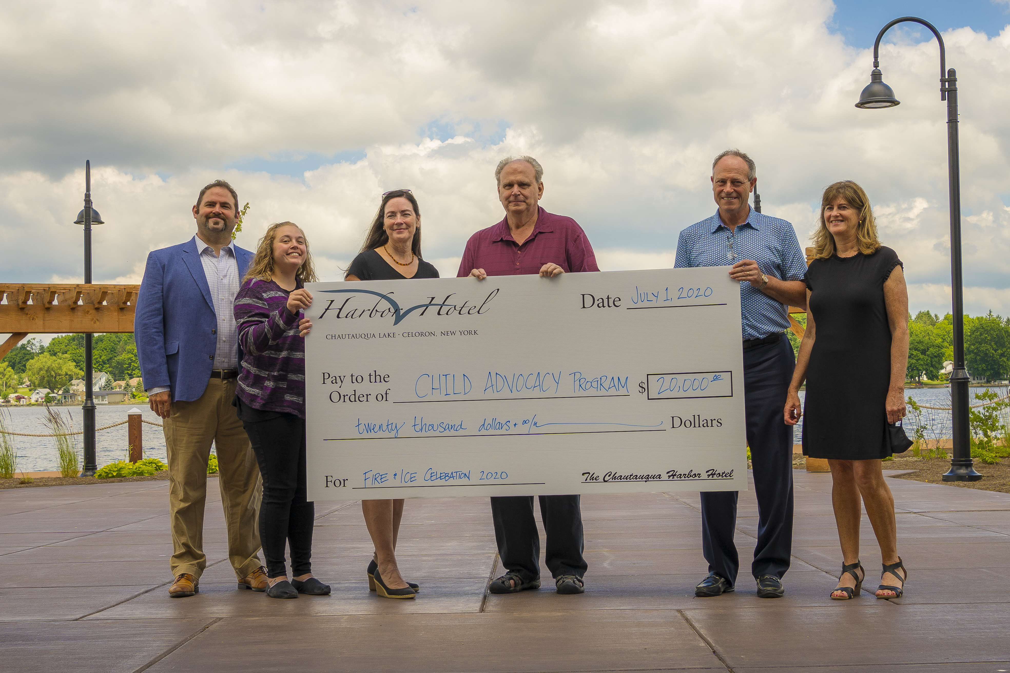 David Hart, President and CEO of Hart Hotels, presents check to Child Advocacy Program.