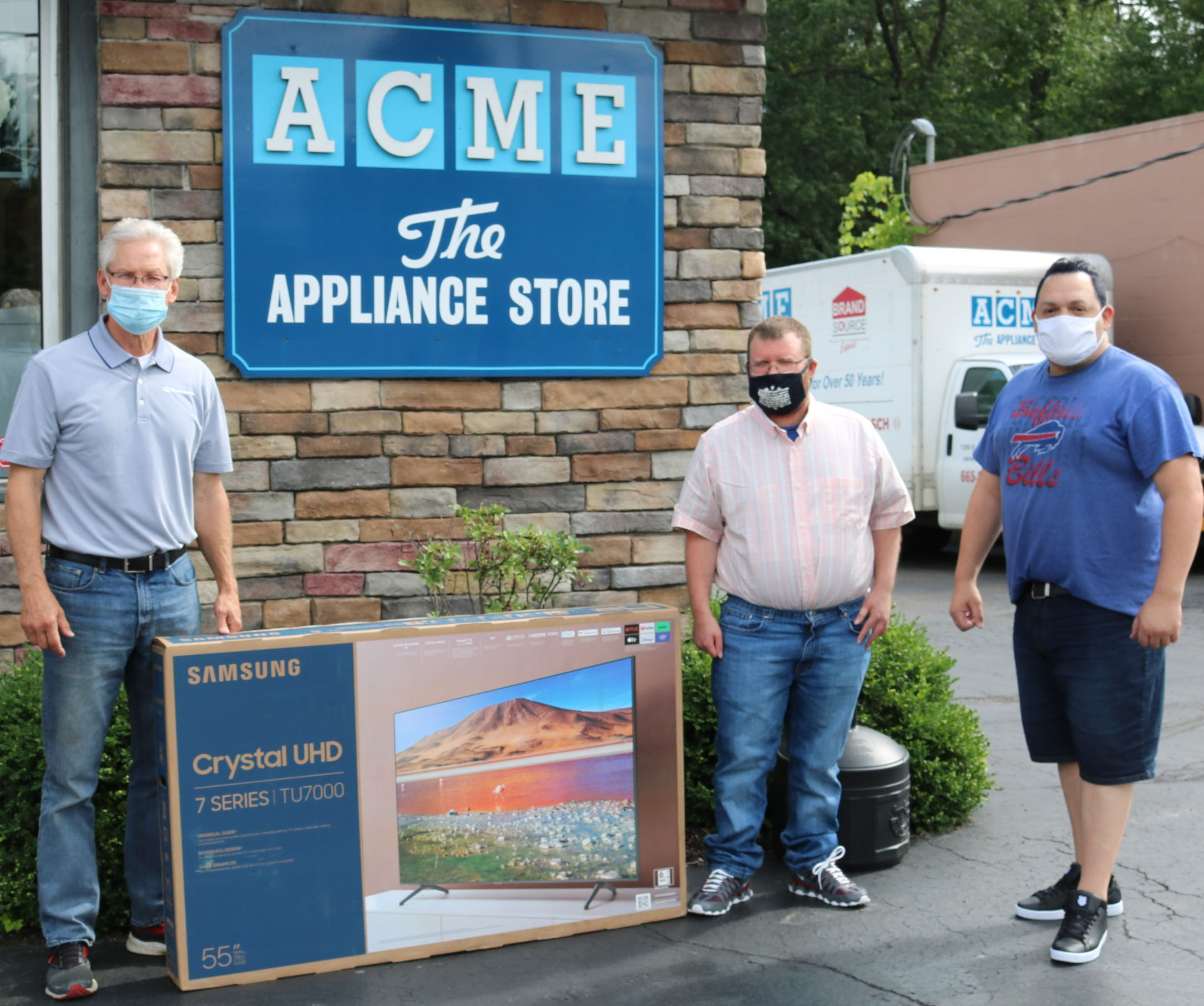 Pictured from left are Dan Hocking, co-owner of ACME The Appliance Store; Steven Rodgers, who was able to attend a Buffalo Bills game thanks to the WOW Fund; and Marcos Figueroa, who was the driving force in creating the WOW Fund.