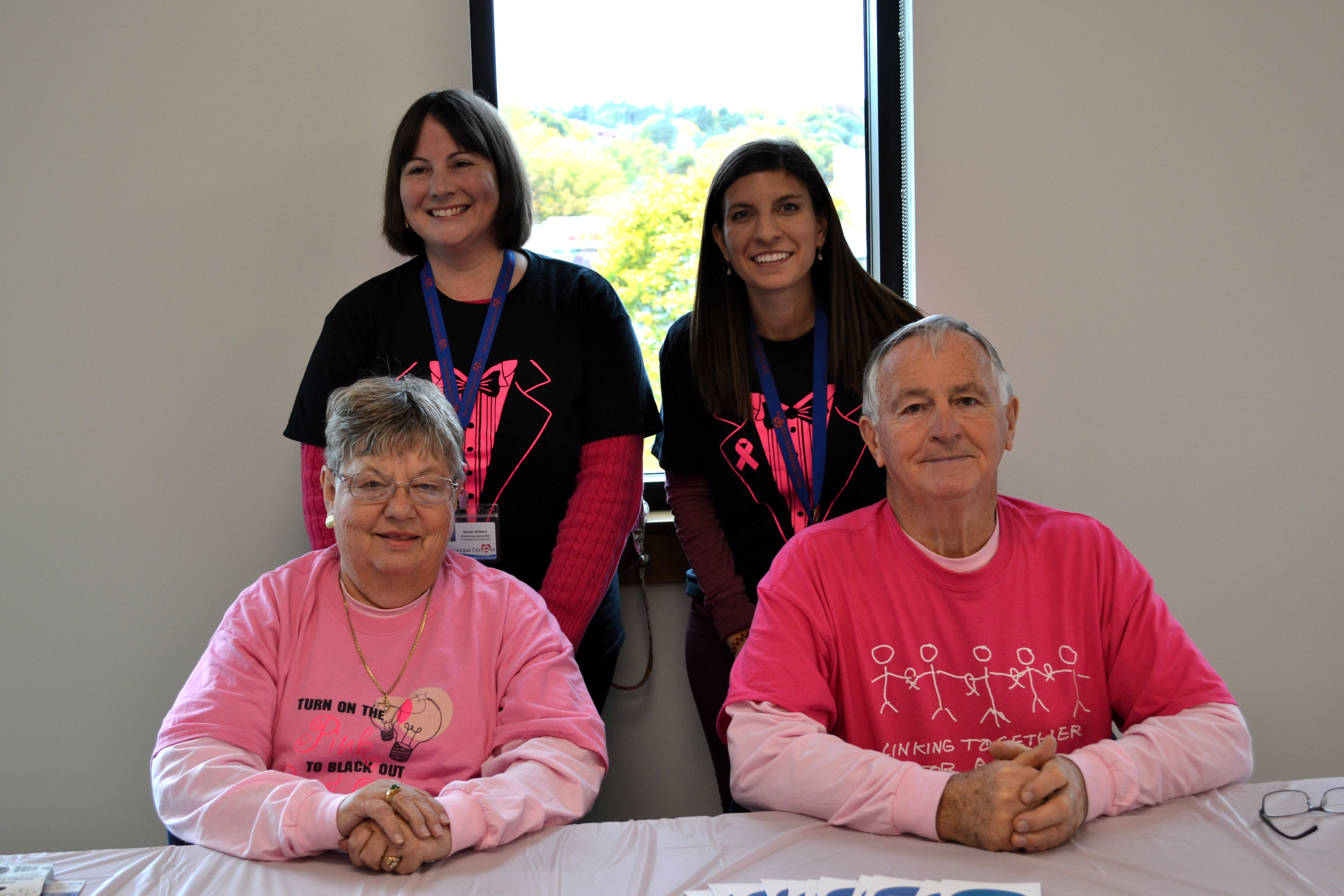 Sarah Gilbert and Alicia Ekstrom, The Chautauqua Center Marketing Specialists and Pat Carr and John Smith, breast cancer survivors and members of the Jamestown Cancer Support Group at last year's in-person event