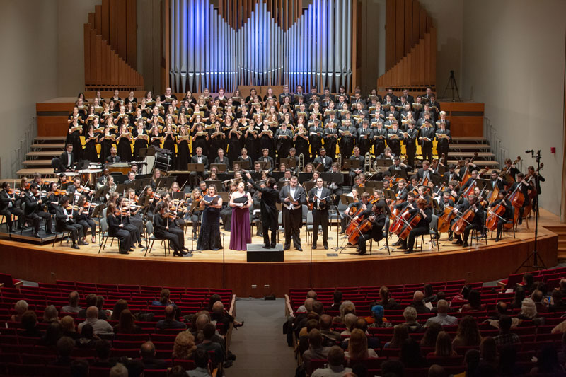 A combined choir/orchestra performance in King Concert Hall.