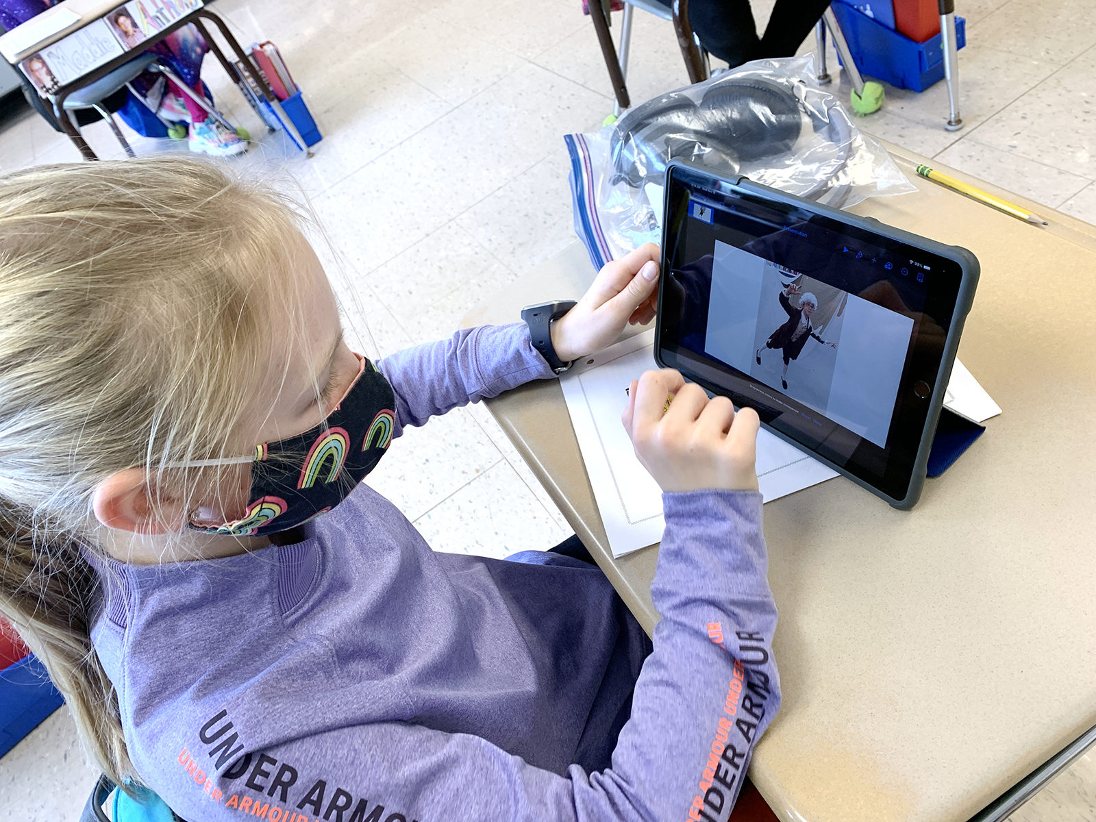 Bush Elementary School fourth grader, Lucy Hockenberry, erases the background of her balloon photo to add a Macy's Thanksgiving Parade photo to include with her ELA persuasive essay.