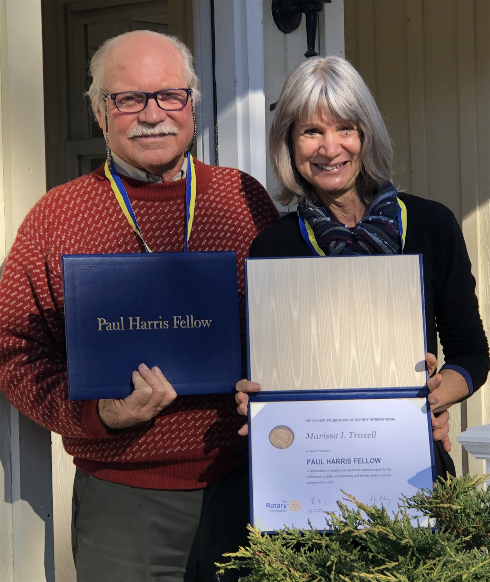 Rotarian David Troxell and his wife Marissa were presented with Paul Harris Awards by Rotarian Dan Overcash and his wife Brigetta at a recent ZOOM meeting of the Rotary Club of Jamestown.