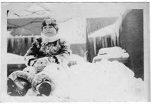 Joan on a snow bank.